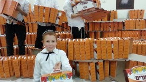Children of Kfar Chabad Prepare Mishloach Manos Packages